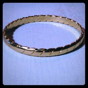 Gold tone bangle signed Monet